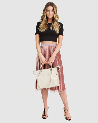 cream-leather-basket-bag-expandable-side-zippers-model-front.jpg