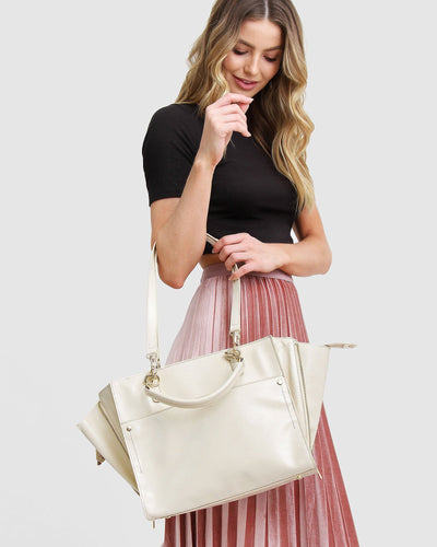 cream-leather-basket-bag-expandable-side-zippers-model-shoulder-strap.jpg