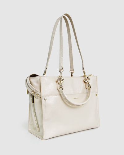 cream-leather-basket-bag-expandable-side-zippers-side.jpg
