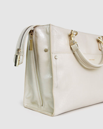 cream-leather-basket-bag-expandable-zippers-side-closed.jpg