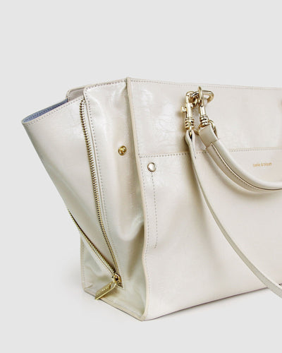 cream-leather-basket-bag-expandable-zippers-side-open.jpg