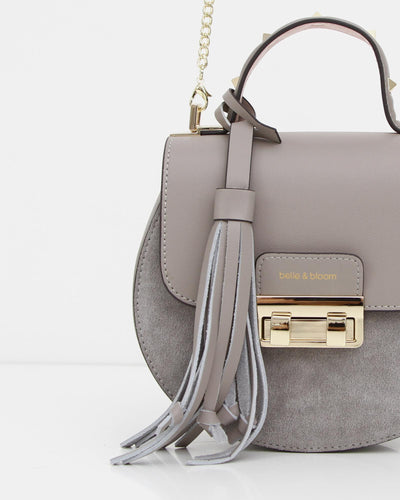 grey-suede-and-leaher-bag-with-fncy-lock-and-tassel.jpg