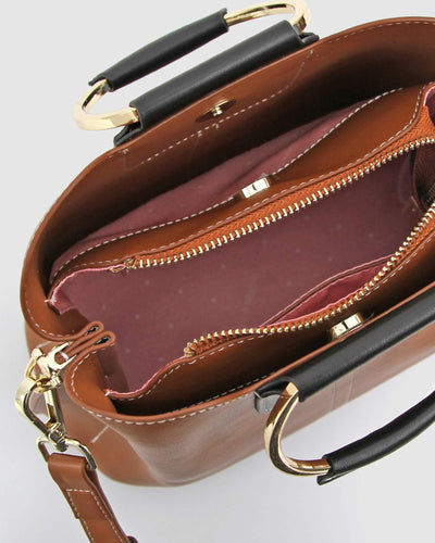 inisde-brown-abd-black-leather-bag-with-pink-lining.jpg