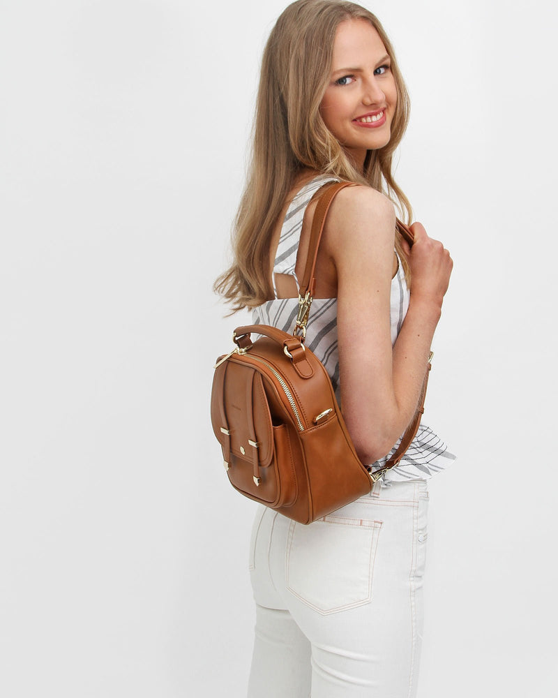 brown-leather-backpack-multi-way-to-ashoulder-bag.jpg