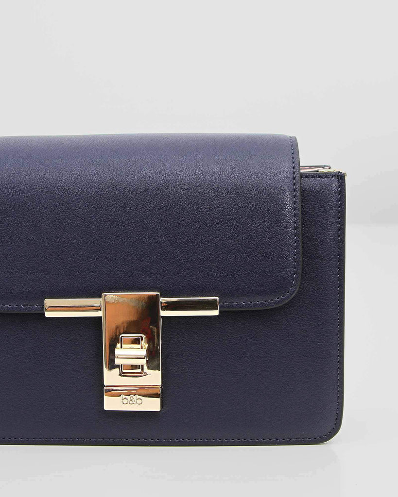 navy-leather-crossbody-with-gold-tone-hardware.jpg