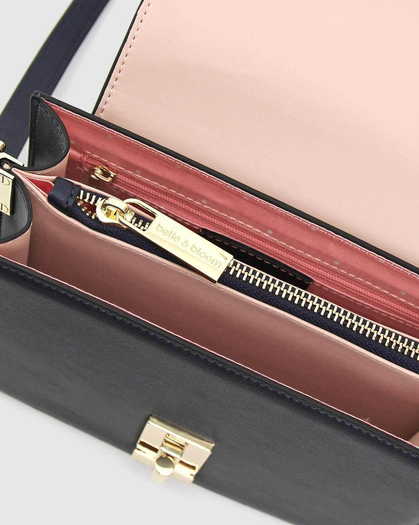 navy-leather-crossbody-with-pink-interior.jpg