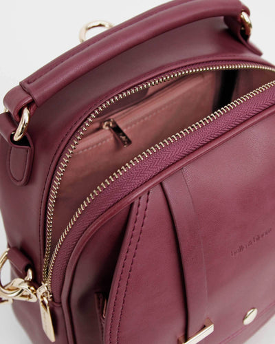 pink-lining-in-purple-leather-bac-pack.jpg