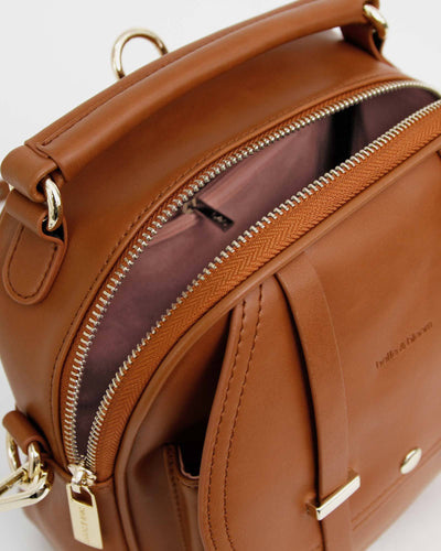 pink-lining-inside-brown-leather-backpack.jpg