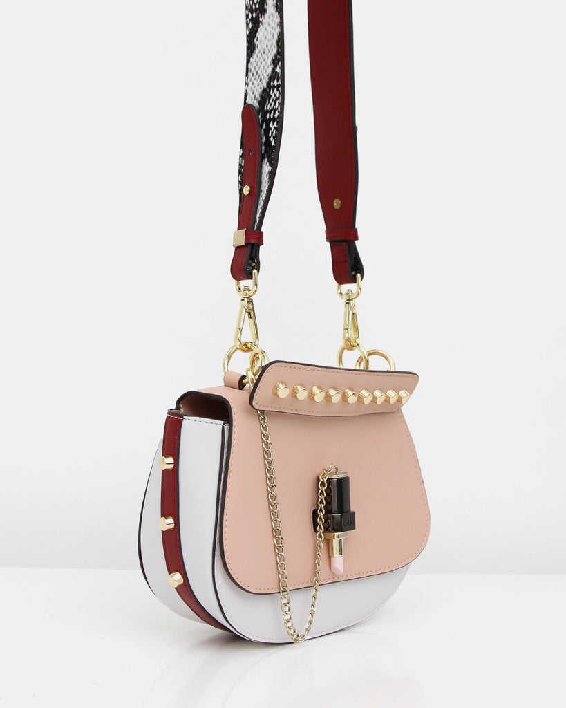 pink%20&%20white%20leather%20cross-body%20with%20lipstick%20and%20studs.jpg