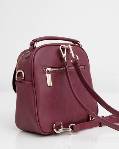 purple-leather-backpack-with-gold-hardware.jpg