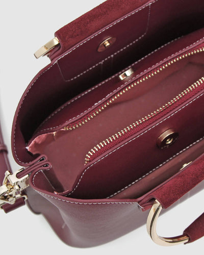 wine-leather-bag-with-pink-lining.jpg