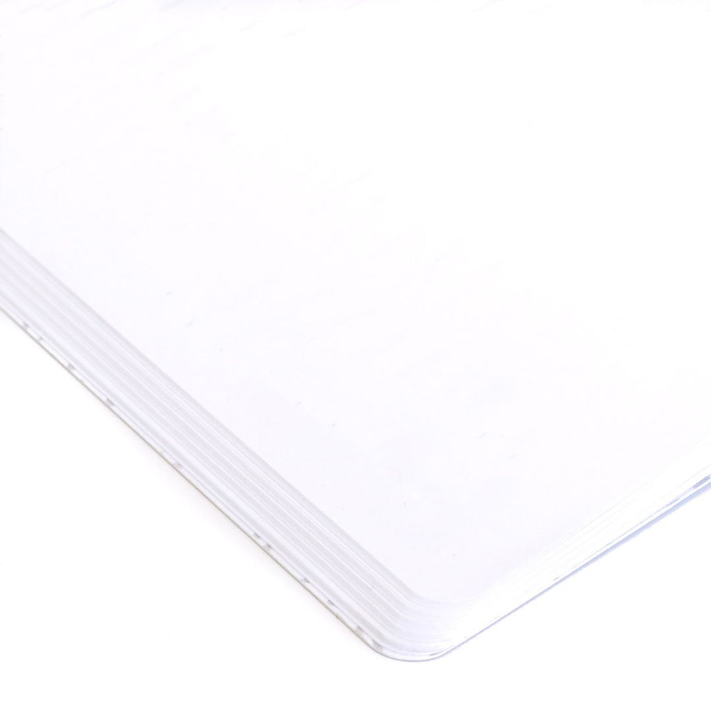 Cream Softcover Notebook blank page closeup