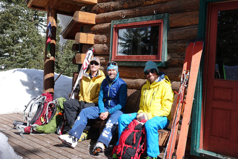 Greg Shaffran (AE ski guide), & team relaxing on the porch of the Friends Hut.