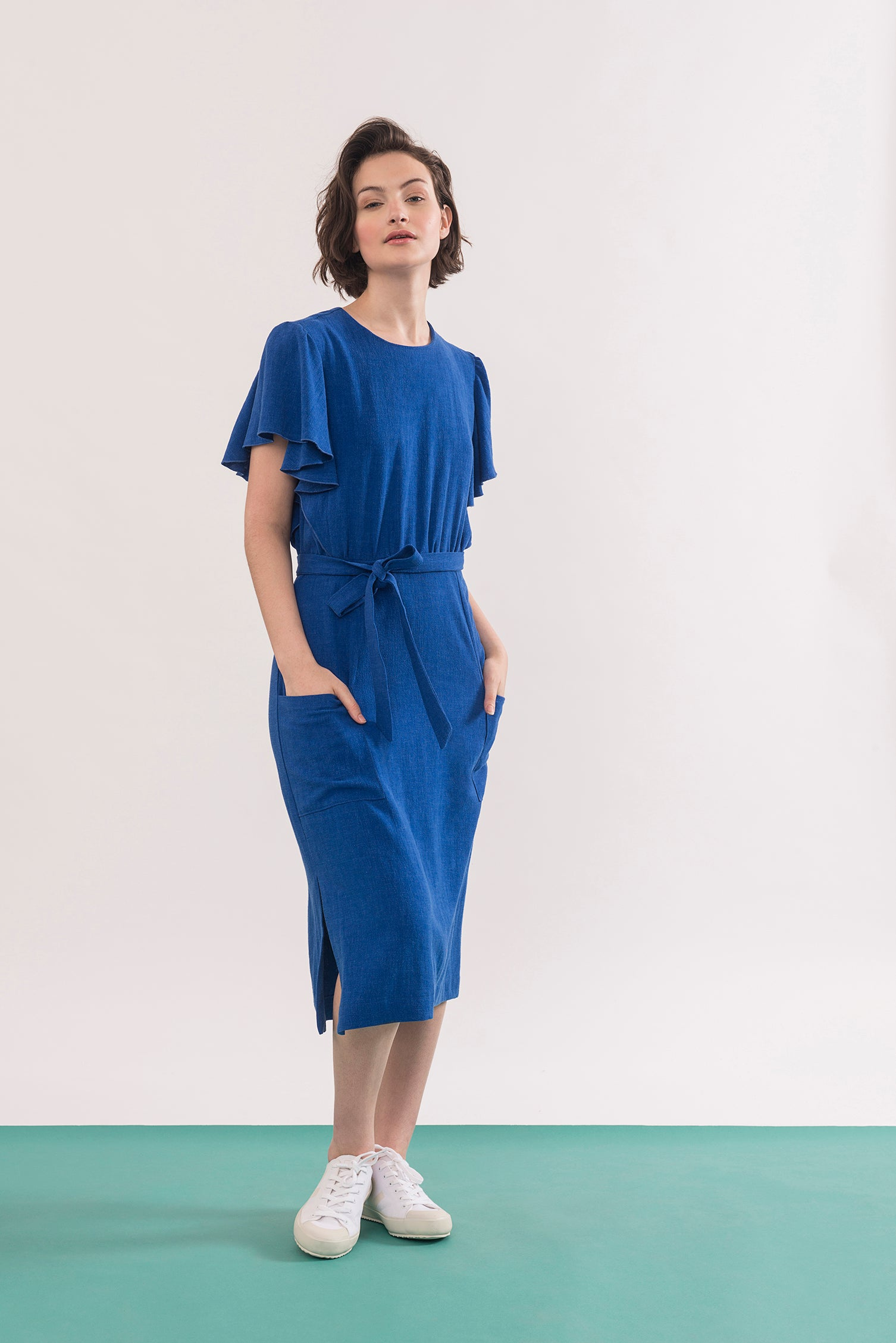 Klee Dress by Jennifer Glasgow, Electric Blue, flowing draped sleeves, mid-length, patch pockets, side vents, belt, rayon and linen, sizes XS to XL, made in Montreal