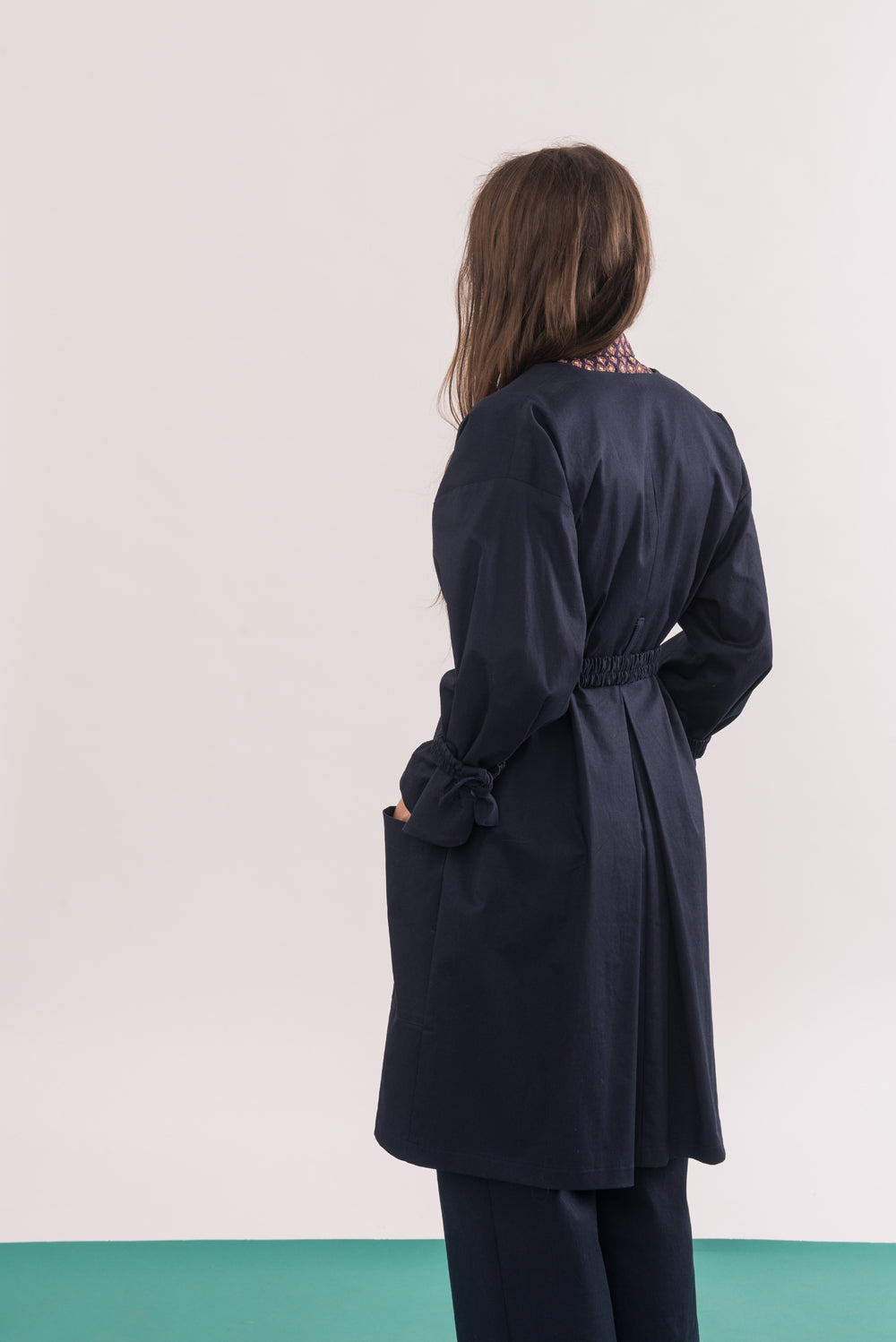 Arbus Jacket by Jennifer Glasgow, Navy, back view, knee-length, broad collar, cinched cuffs, removable belt, eco fabric, OEKO-TEX Standard 100, sizes XS to XL, made in Montreal