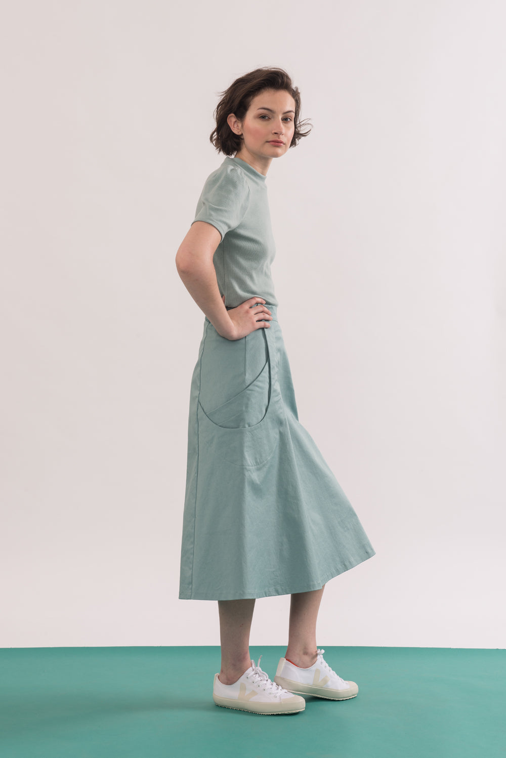 Abramovic Skirt by Jennifer Glasgow, Seafoam, side view, A-line skirt, midi length, origami pockets, organic cotton twill, eco fabric, OEKO-TEX certified Standard 100, sizes XS to XL, made in Montreal Canada