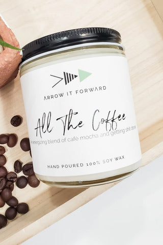 All The Coffee candle by Arrow It Forward in a reusable glass jar, styled with coffee beans