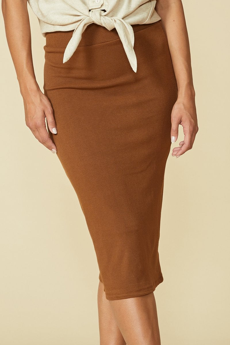 Balance skirt by Cokluch in Tobacco; warm cinnamon shade; slim fitting; high-waisted; hits below the knee; detail front view