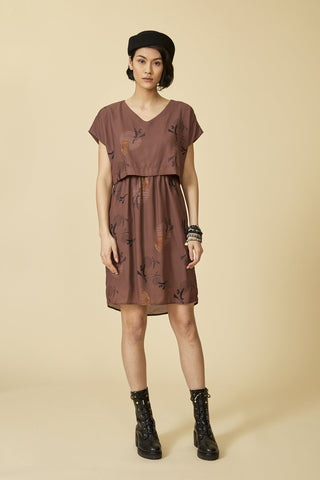 Biela dress by Cokluch; muted copper amaretto shade with a neutral graphic print; fluid silhouette with a cropped t-shirt effect; short-sleeved; v-neckline; knee-length; full length front view; styled with black ankle boots