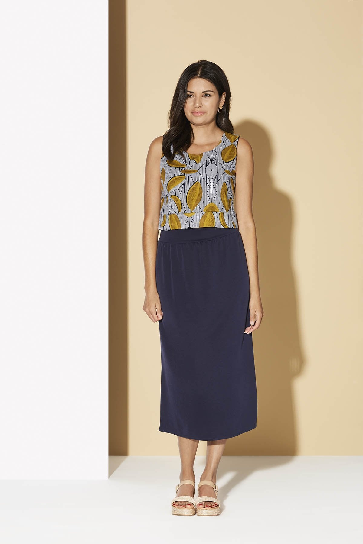 Yumbilla Skirt by Cherry Bobin, Navy, midi-length, elastic waist, belt, modal blend, sizes XS to XL, made in Quebec