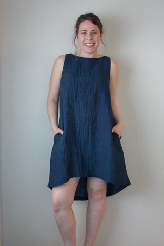 Violet Dress by Copious Couture, Indigo, sleeveless, cotton linen, open neck, A-line, asymmetrical hem, pockets, sizes XS to XL, made in Canada