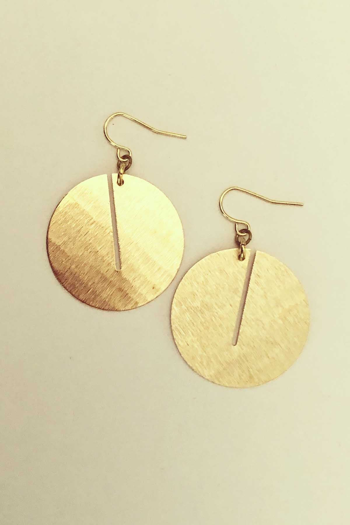 Eghah Earrings by Darlings of Denmark, brushed raw brass, circular dangle, circles with slits, made in Montreal