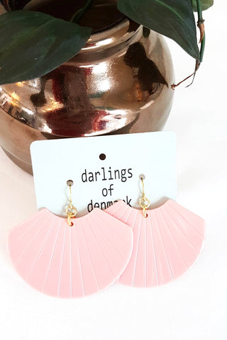 Lottie earrings by Darlings of Denmark; acrylic shell-shaped earrings in light pink; flat lay