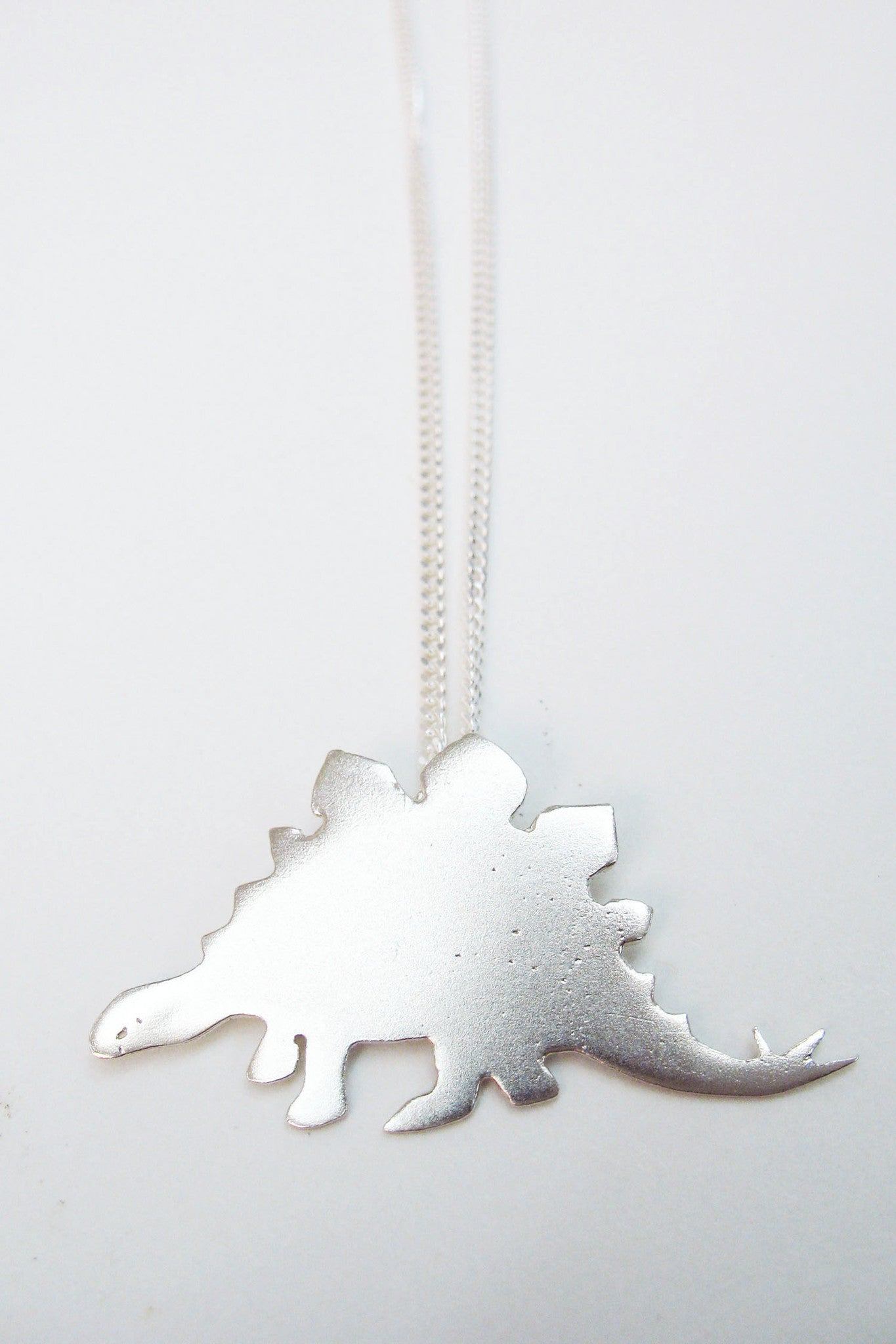 Sterling Silver Stegasaurus Dinosaur necklace by Slashpile Designs