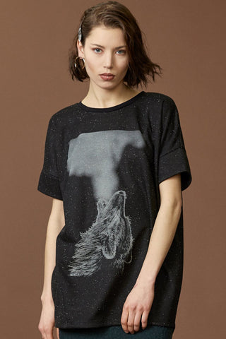 Wild tunic by Cokluch; black speckled material; grey silkscreened wolf graphic; drop-shoulder; rounded neckline; detail front view
