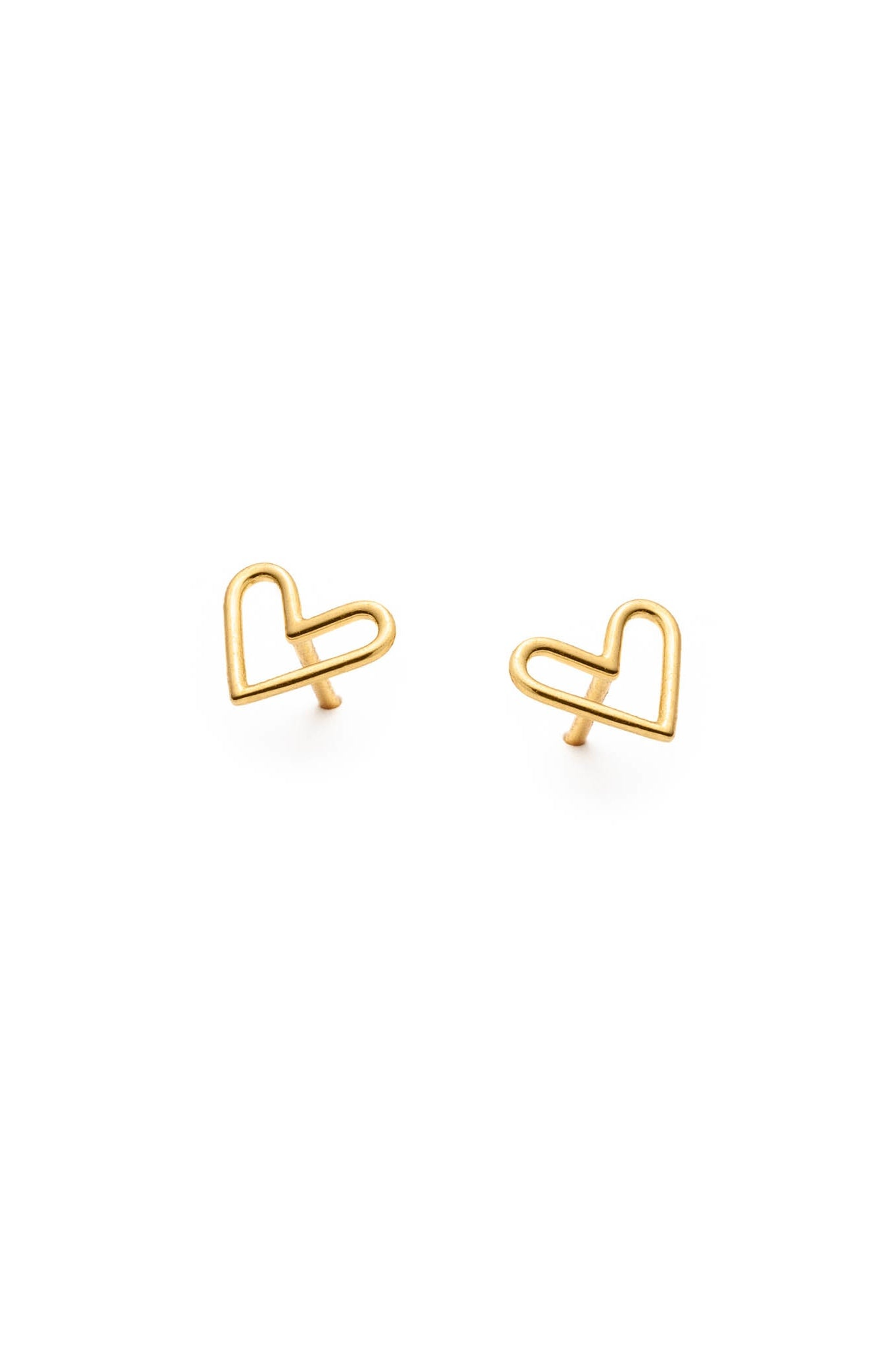 Heart stud earrings by Lidia; flat lay; 14k yellow gold plated silver