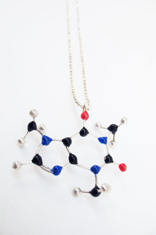 Coffee Addicts show off your love of good cuppa joe with this caffeine molecule necklace by Slashpile