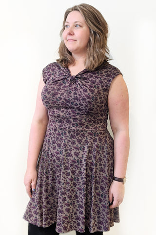 Constance Dress by Hericher, plum floral, fit and flare, knot at front neckline, V-neck at back, sizes XS to XL, made in Quebec