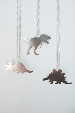 Sterling Silver dinosaur necklaces by Slashpile Designs