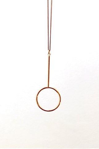 Duille necklace by Darlings of Denmark; gold-plated brass; long chain; pendulum charm; flat lay