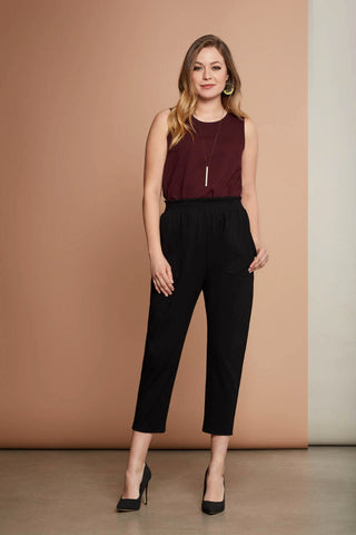 Echo cami in burgundy by Cherry Bobin; rounded neckline, sleeveless; tucked into black, high-waisted trousers; styled with a minimalist necklace and black high heels