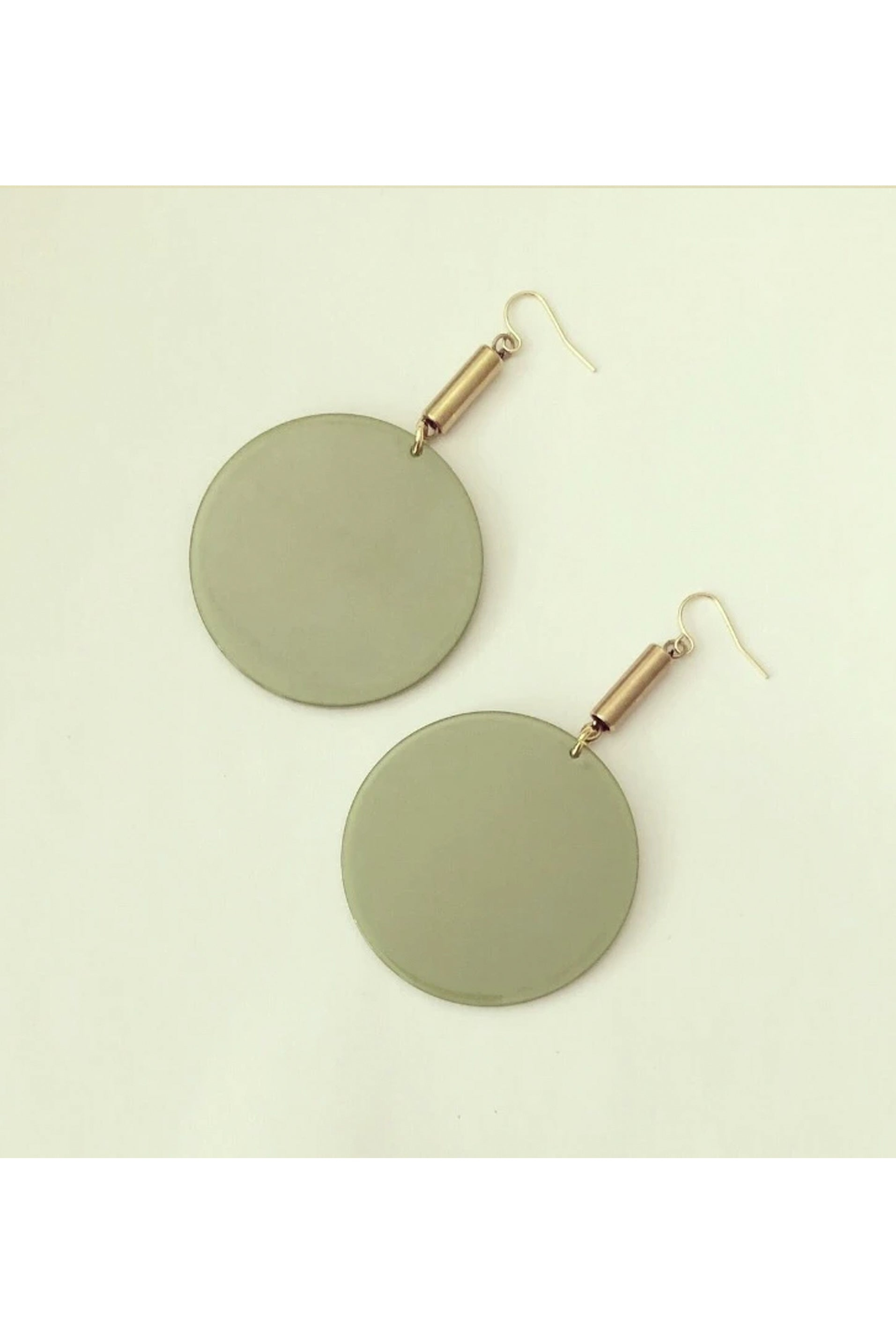 Flumme by Darlings of Denmark; flat lay; dangle earrings; raw brass tubes with green acrylic circle details