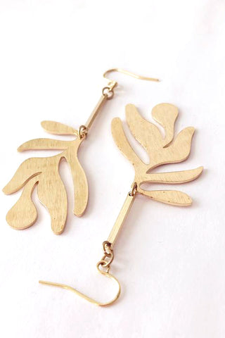 Fullie dangle earrings by Darlings of Denmark; brushed texture raw brass; abstract leaf hanging off slim brass bars; flat lay