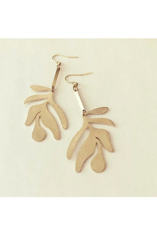 Fullie dangle earrings by Darlings of Denmark; smooth raw brass; abstract leaf hanging off slim brass bars; flat lay