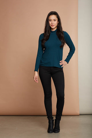 Pyrola Turtleneck by Cherry Bobin in Turquoise; styled with black skinny jeans and black leather boots