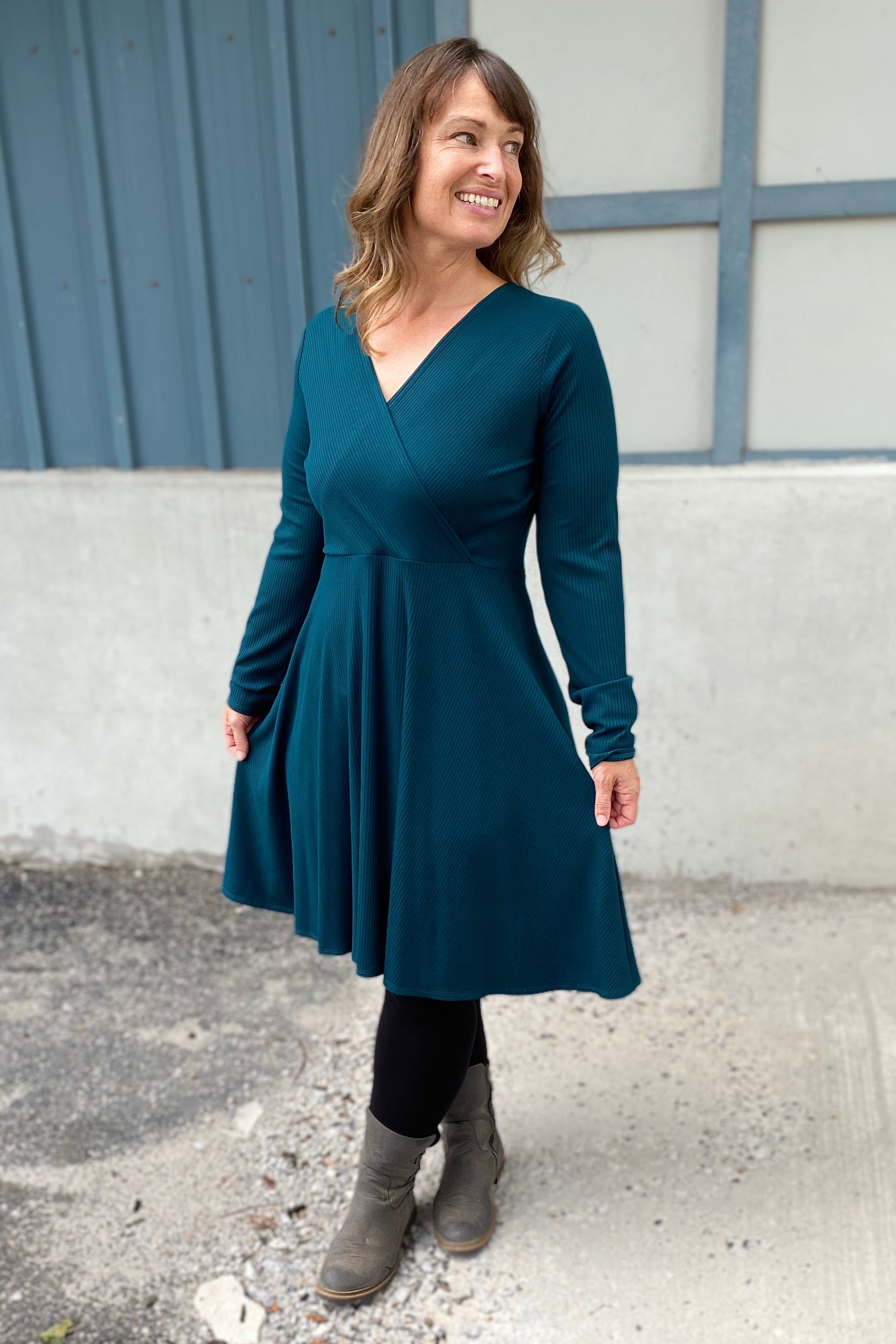 Vera dress by Cherry Bobin in Turquoise; bamboo ribbed knit wrap dress; long sleeved, mid-length; styled with black leggings and grey boots
