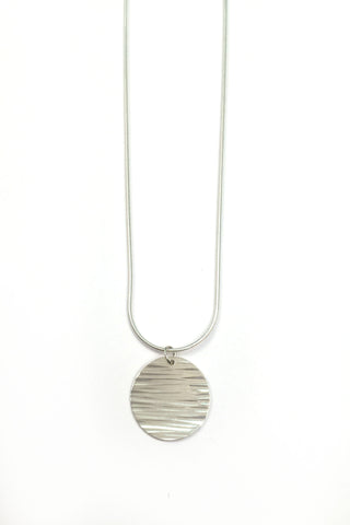 Jessie Phoenix - Little moon Disc necklace with lines. Hand hammered sterling silver made in Vancouver, BC