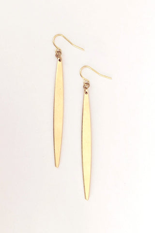 Luttu earrings by Darlings of Denmark; slim, spear-shaped; raw brass; dangle earrings; flat lay