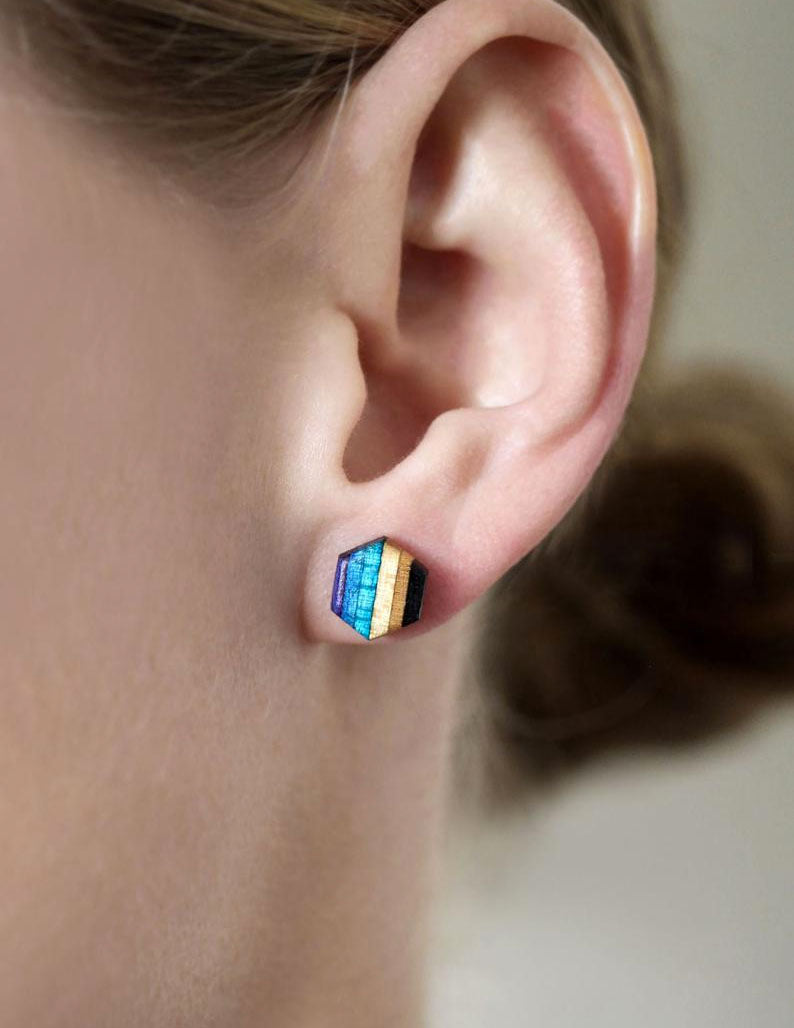 Hexagon stud earrings made from repurposed skateboards