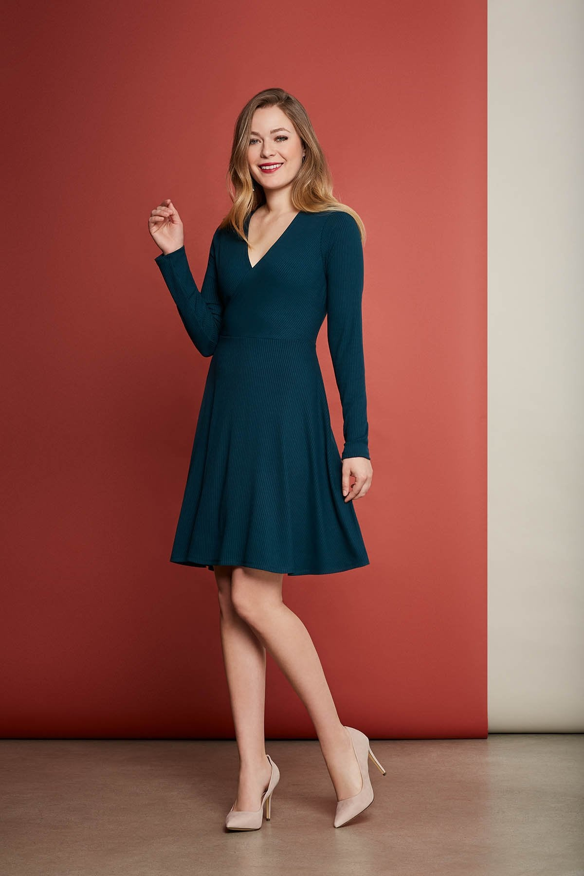 Vera dress by Cherry Bobin in Turquoise; bamboo ribbed knit wrap dress; long sleeved, mid-length; styled with nude high heels