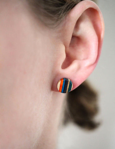 Small round stud earrings made from repurposed skateboards