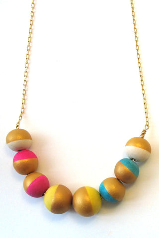 Workshop Boutique, hand painted wood bead necklace, pink,yellow, teal gold white. handmade in Ottawa, Canada