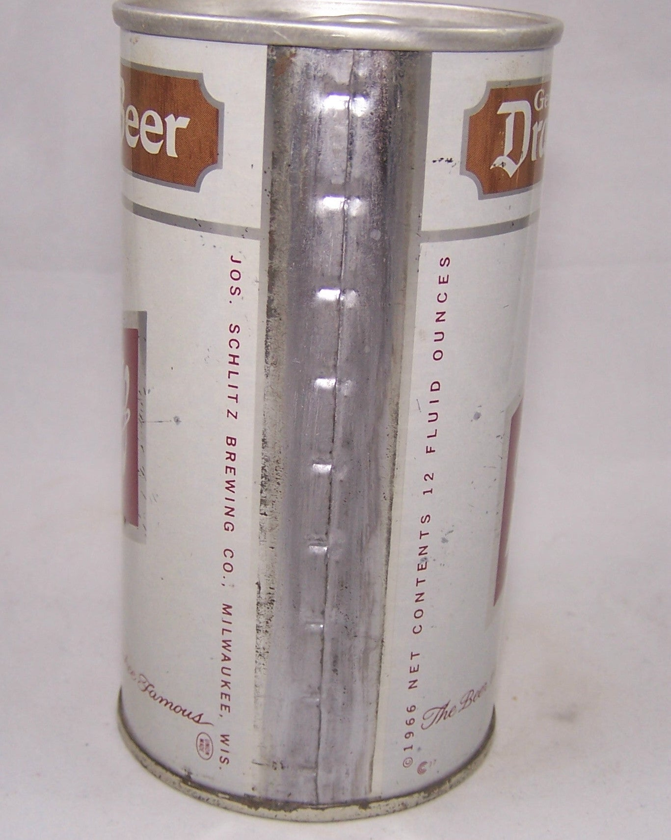 Schlitz Genuine Draught Beer, USBC II 121-04, Grade 1 or better. Sold on 07/22/16
