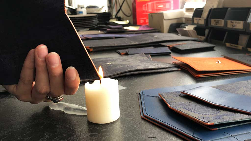 Thread searing with traditional leather workers candle