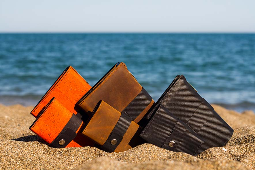 Vanacci Traveller Classic travel wallets, row of three, orange cork leather, indy leather, mach leather, with Tasca Classic wallets in foreground