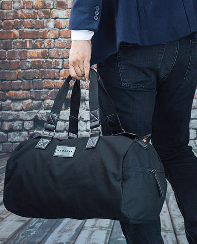 Vanacci canvas duffle bag front  held by a man